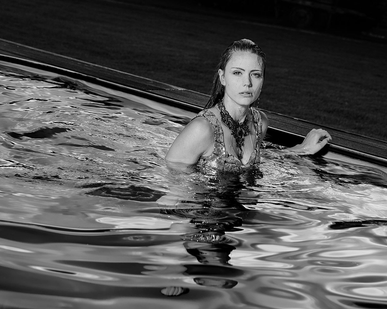 Fashion and Pool - Toni swim with silver Dress in the Pool, by Gunnar Wöbse